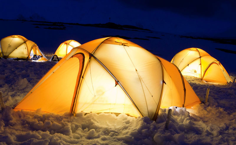 antarctic camping on ice tents lit up at night oc