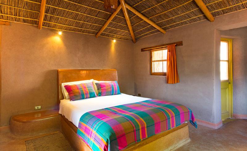 chile atacama hotel altiplanico bedroom colourful cscda