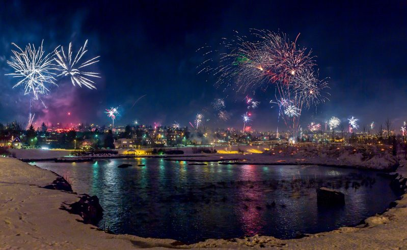 iceland reykjavik new year fireworks across lake rth