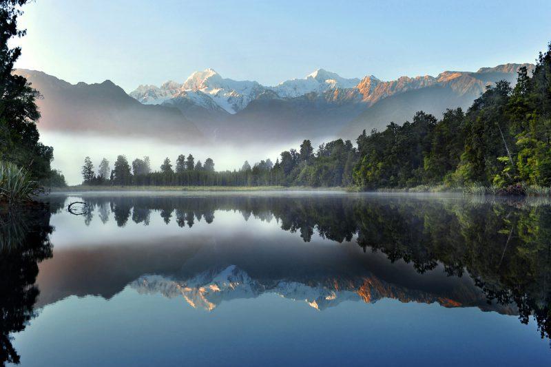 new zealand west coast lake matheson misty morning sstk