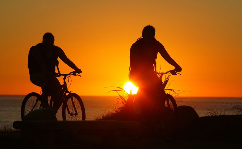 new zealand western north island cyclists sunset vt