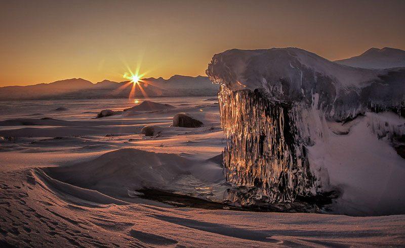 swedish lapland stora sjofallet winter sun over frozen landscape ss