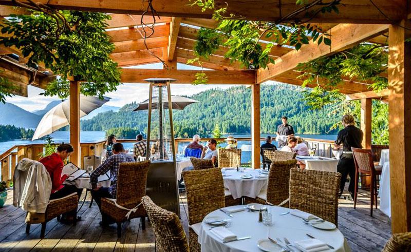 west coast wilderness lodge dinner on upper deck