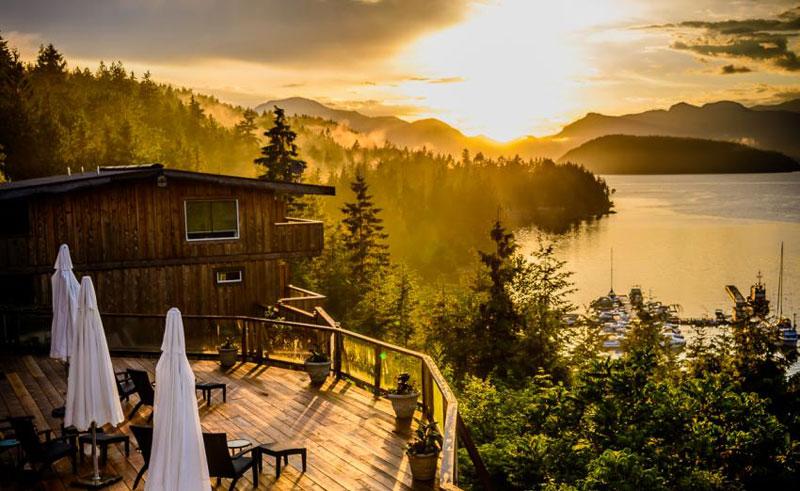 west coast wilderness lodge sunset view upper deck