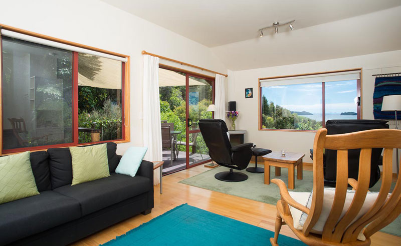 abel tasman ocean view chalets living area