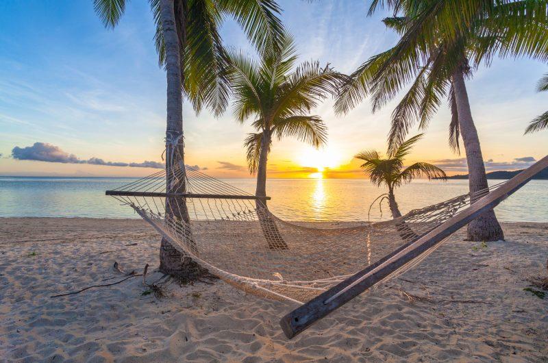 fiji beach hammock at sunset istk