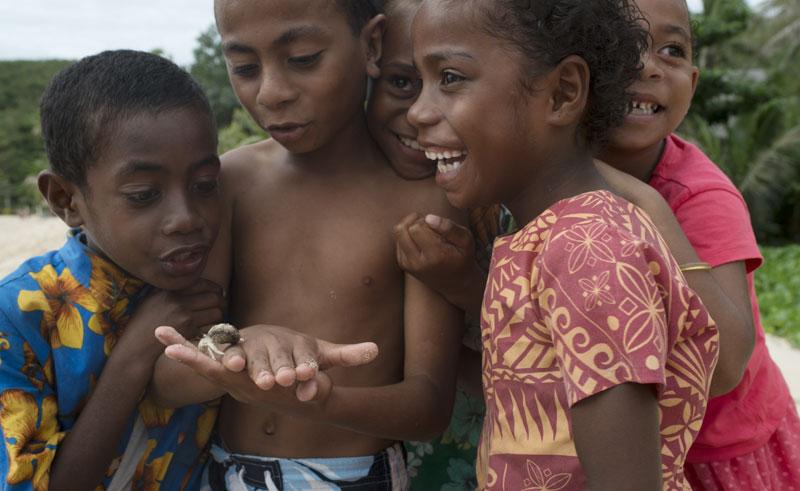 fiji local children with hermit crab tf