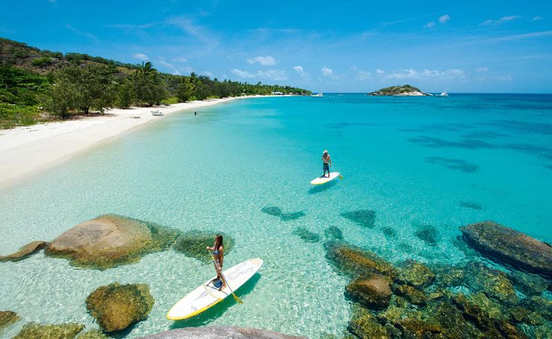 lizard island beach paddleboarders