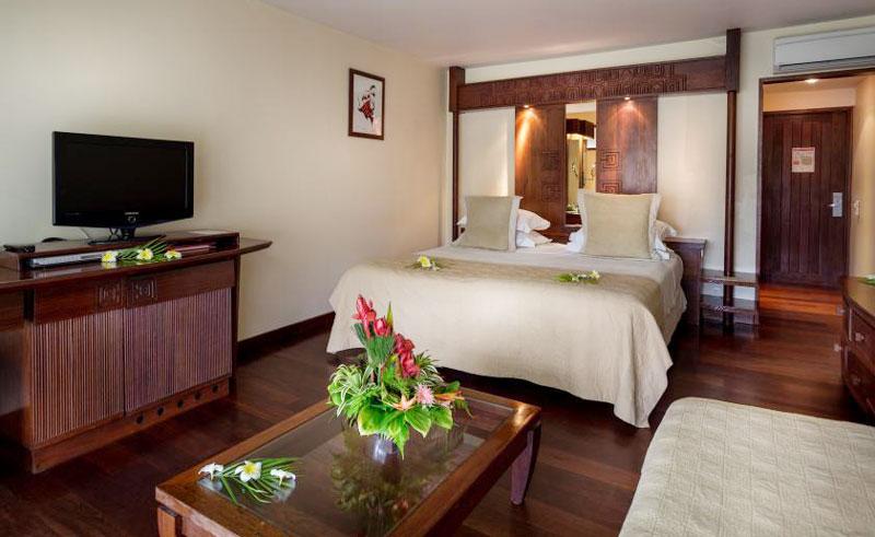 manava beach resort and spa garden room interior