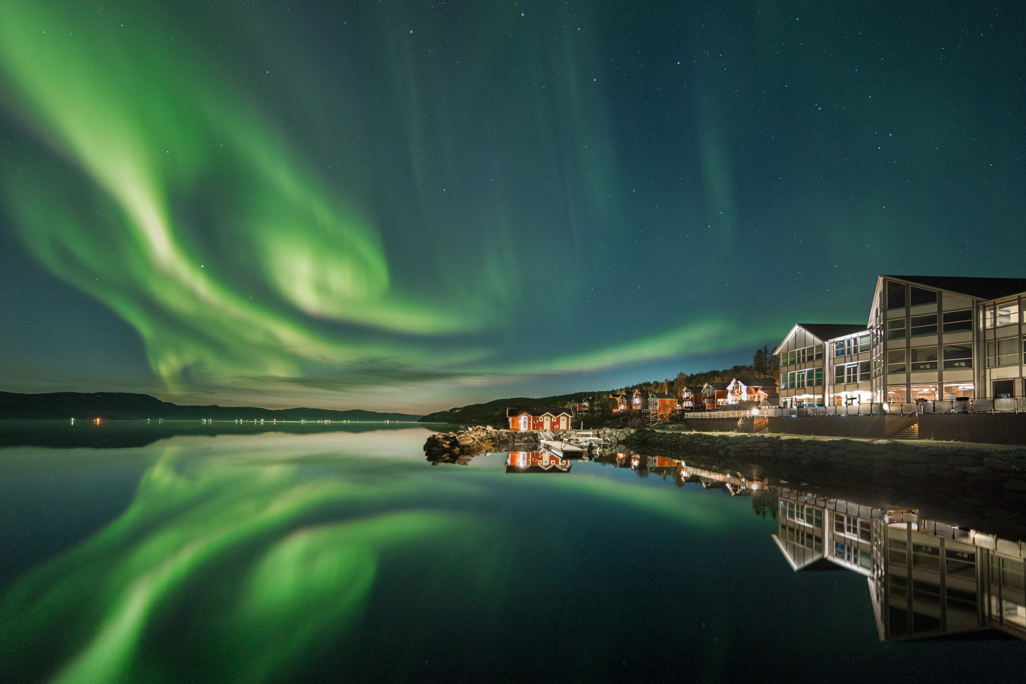 northern norway malangen resort aurora over fjord