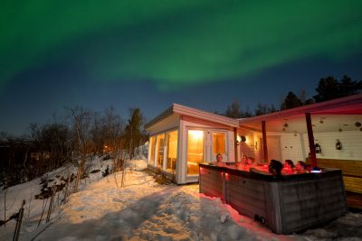 norway northern malangen hot tub party with aurora