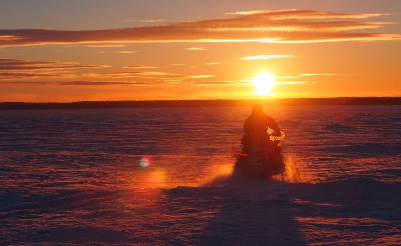 swedish lapland snowmobile tour to the lulea archipelago sunset