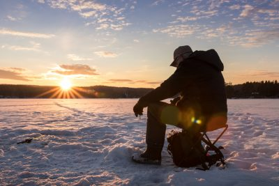 lapland man ice fishing istk
