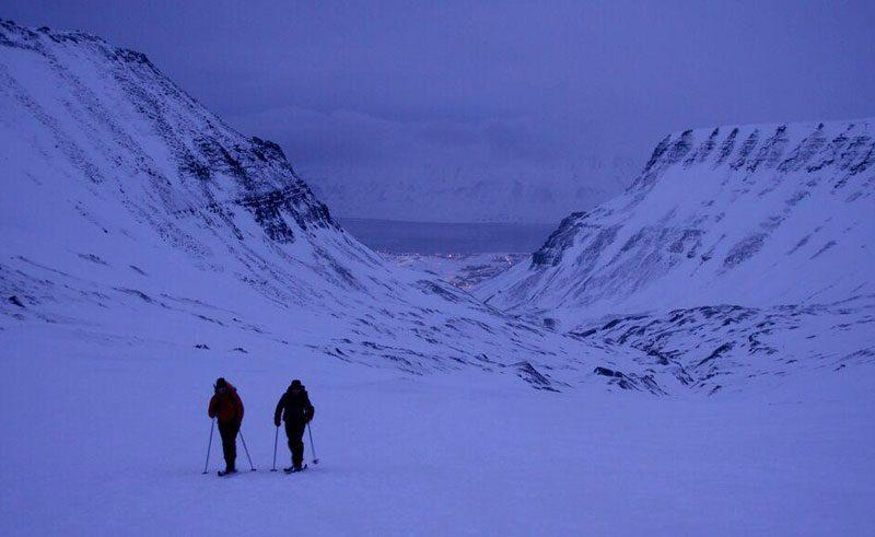 melanie windridge hiking through snow violet dusk