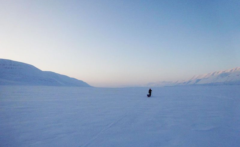 melanie windridge hiking through vast snow