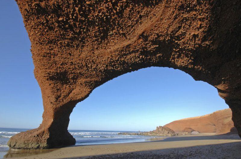 morocco legzira beach rock arch istock