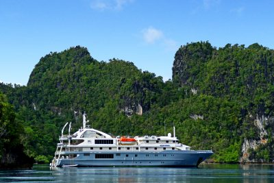 papua new guinea coral discover vessel with backdrop ce