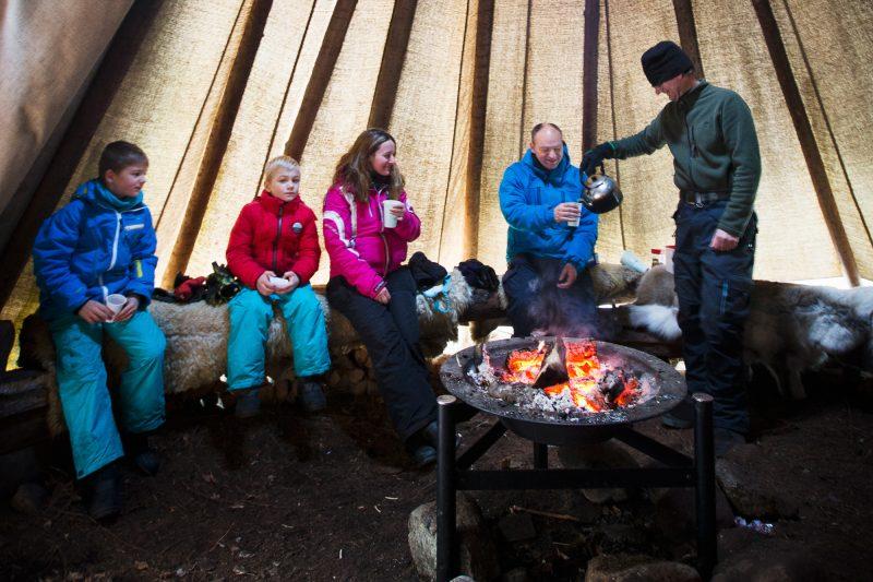 sweden varmland winter family at campfire in lavvu wtrwld