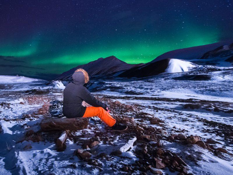 svalbard aurora with person istk