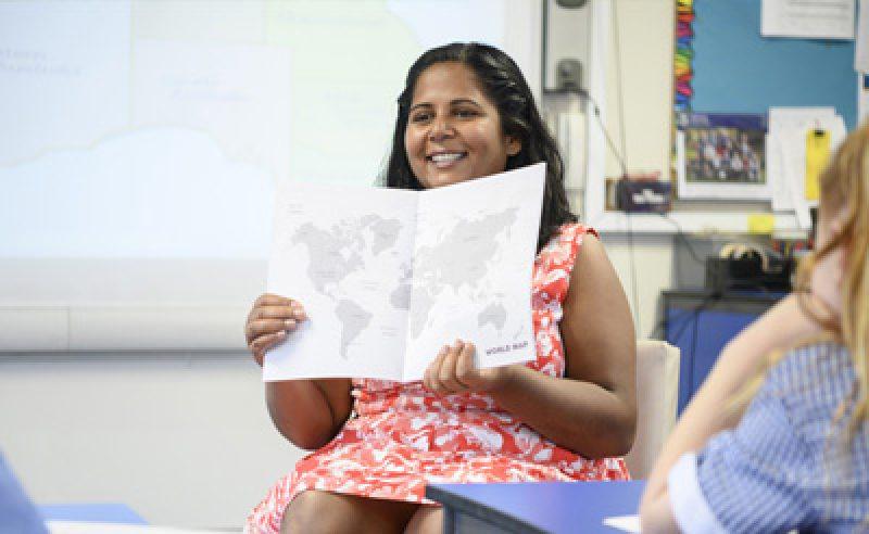 teacher with map 400