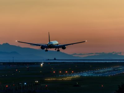 canada plane landing at sunset istk