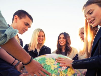 education students looking at inflatable globe istk