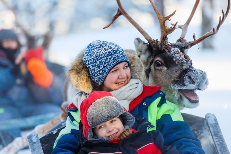 swedish lapland happy reindeer family safari ride adstk
