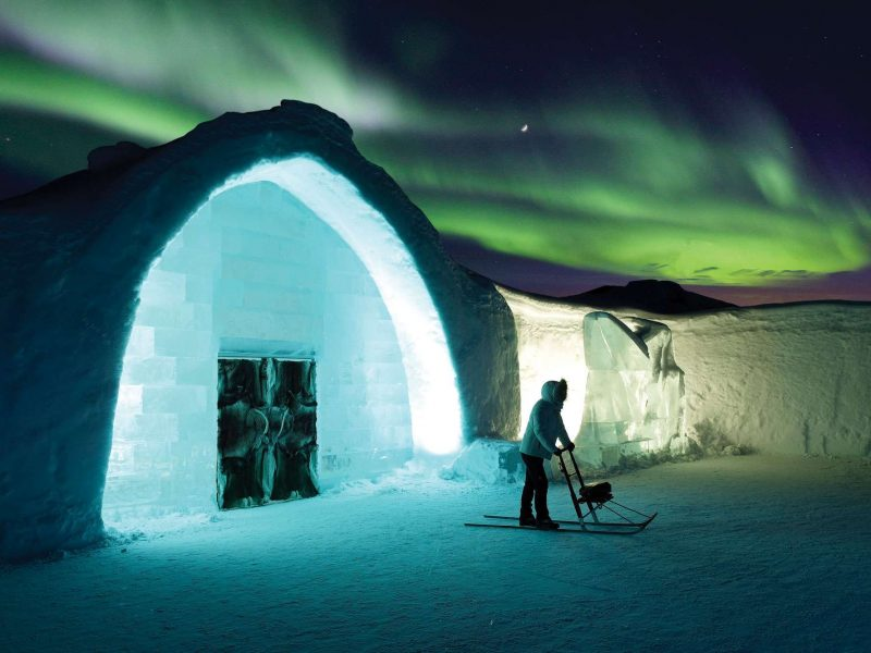 northern lights over the icehotel in Swedish Lapland