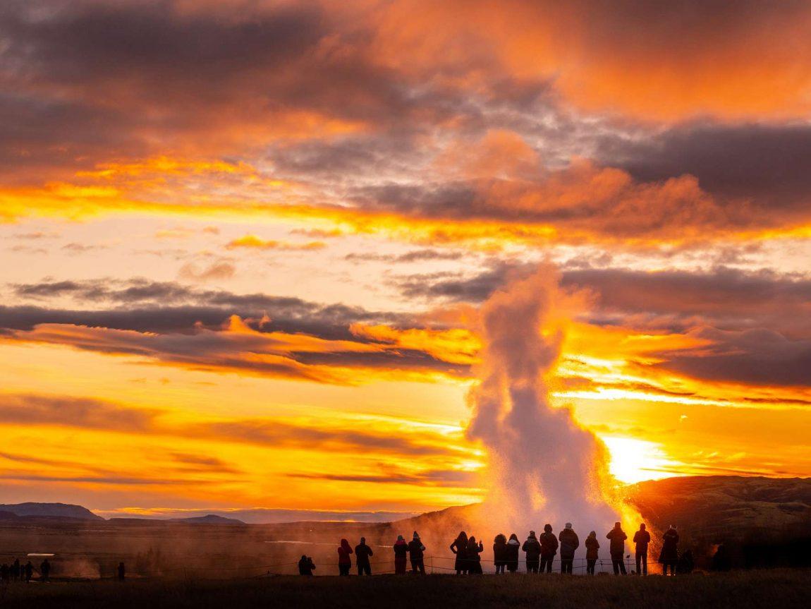 iceland south west strokkur geysir sunset people istk