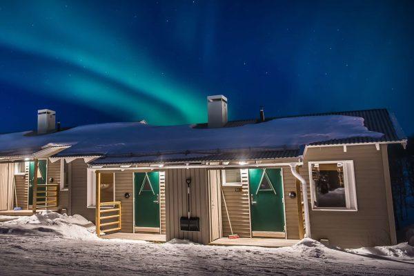 swedish lapland ripan aurora over cabins cr js