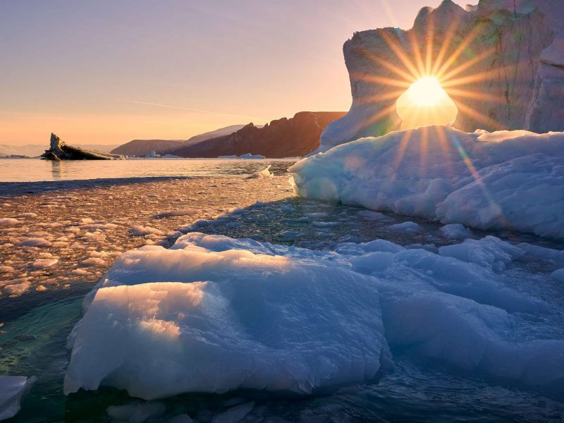 east greenland scoresbysund sunlight through ice rth