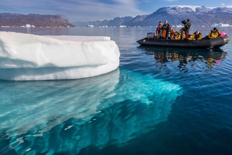 east greenland scoresbysund zodiac water view of iceberg rth