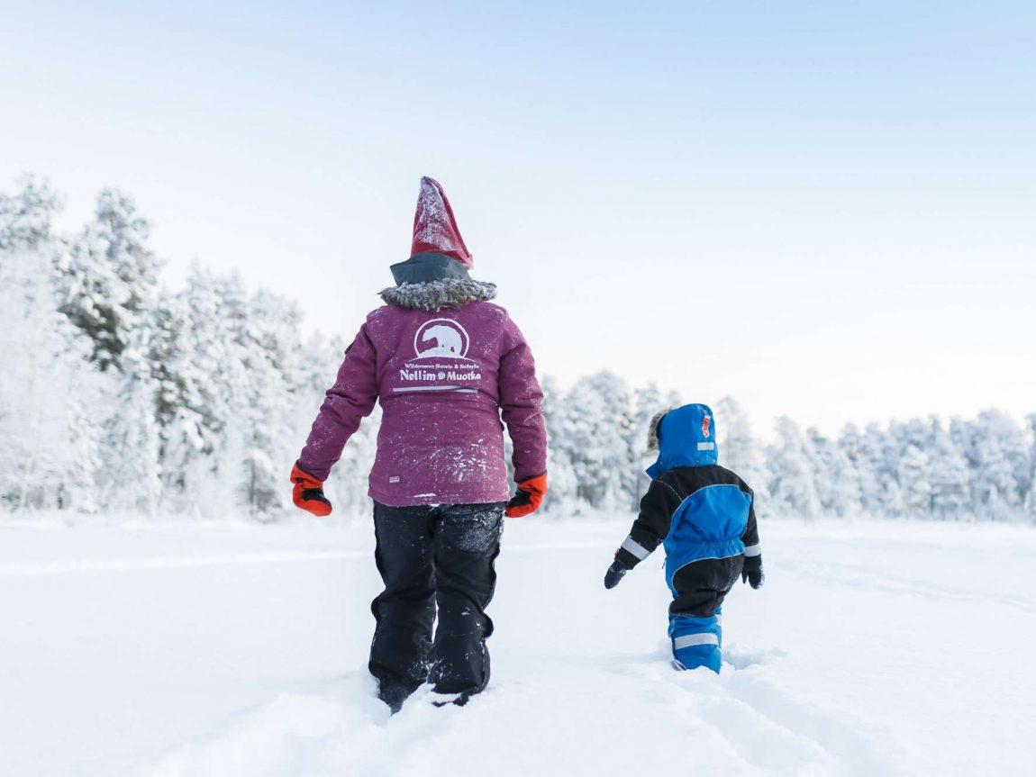 finnish lapland nellim adult child in snow