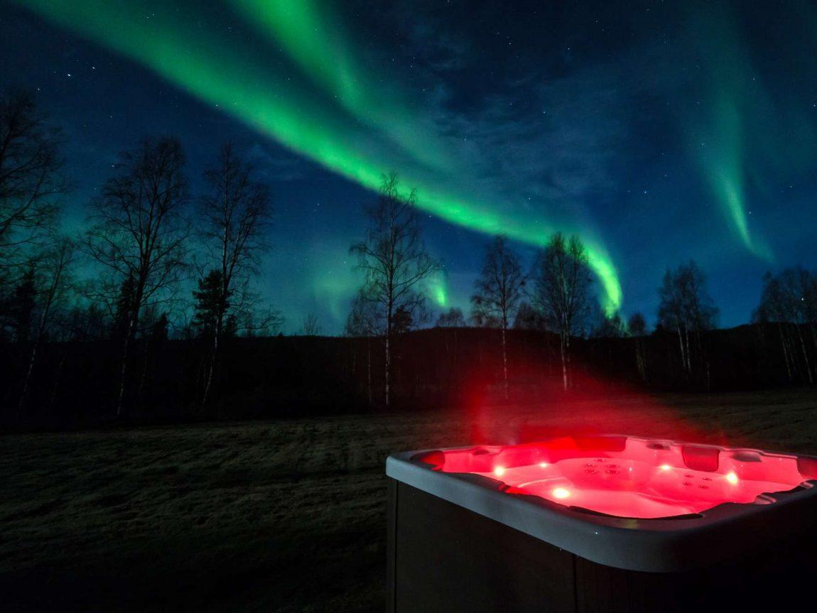 swedish lapland loggers lodge aurora outdoor jacuzzi ll