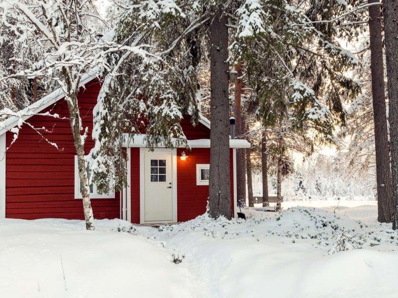swedish lapland loggers lodge exterior trees ll