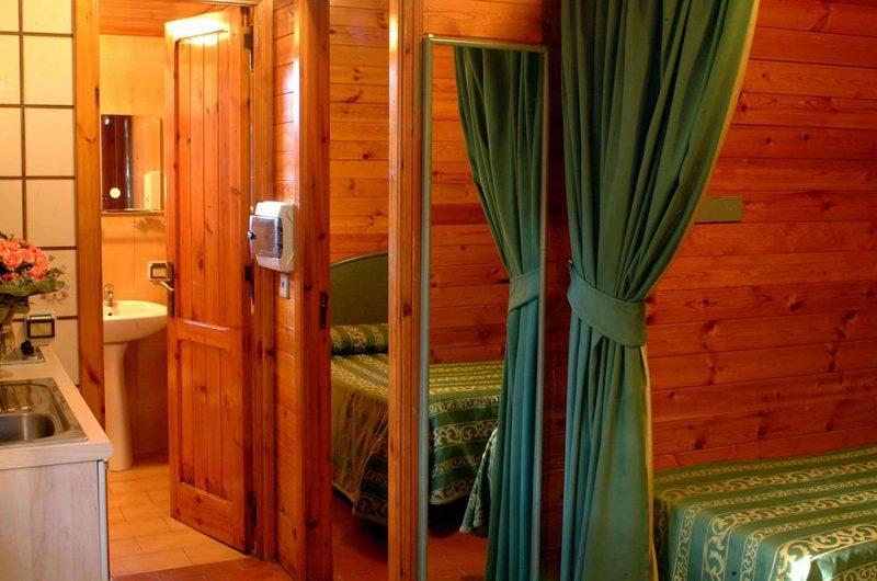 edu bon hotel villaggio bedroom