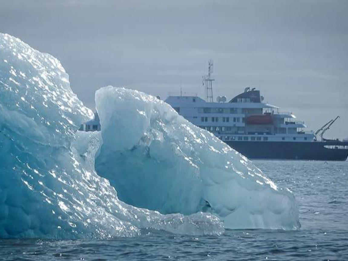 blue ice framing hondius in spitsbergen cp