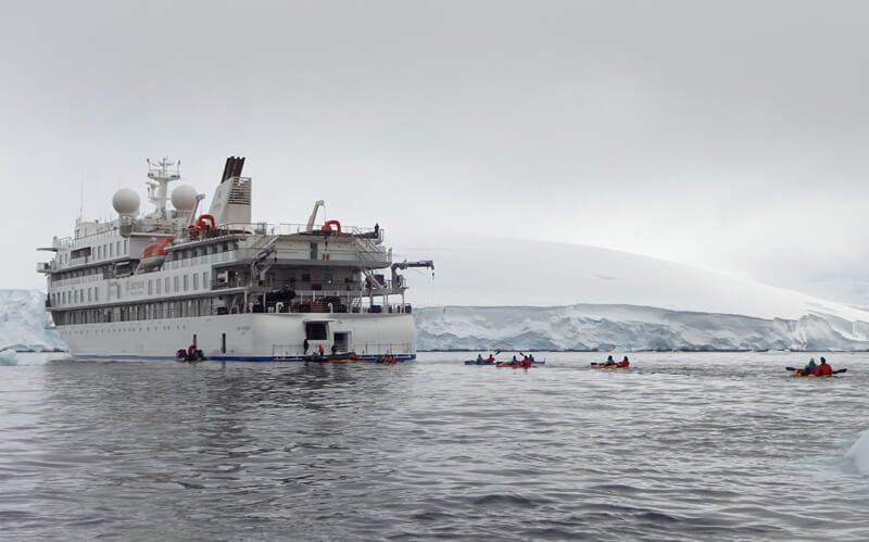 greg mortimer with kayaks in antarctica cp