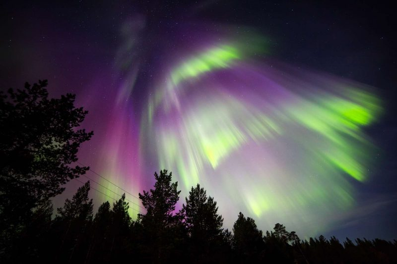 finnish lapland red and green northern lights nellim