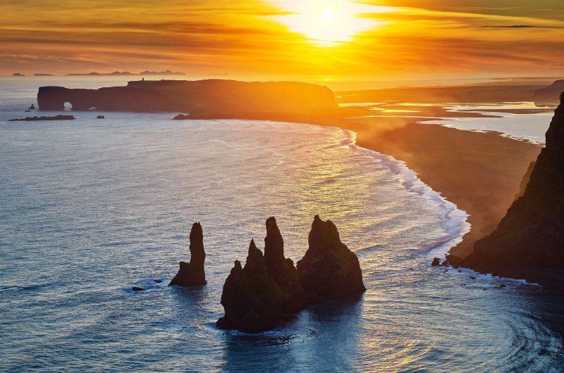 south coast iceland reynisdrangar rock stacks evening sun rth