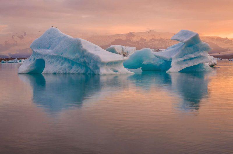 iceland jokulsarlon iceberg reflection at sunset rth