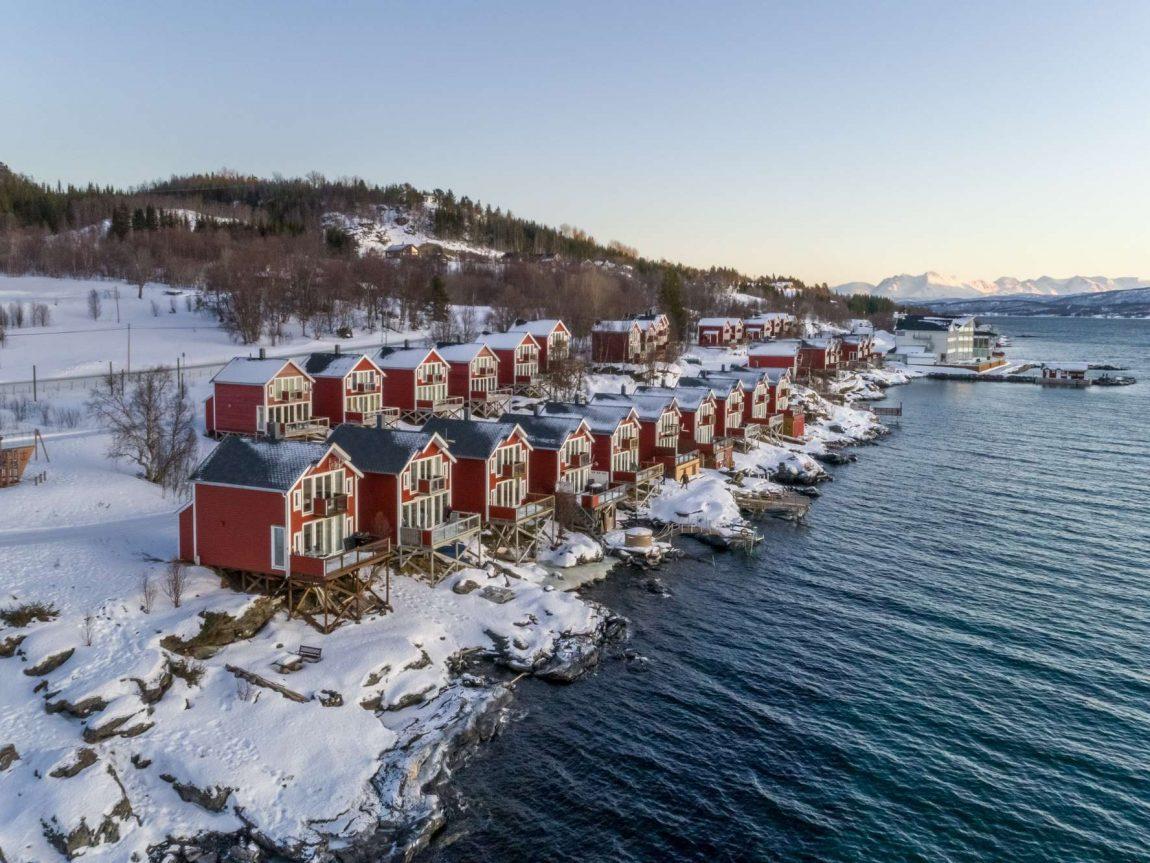 malangen resort cabins along fjord winter