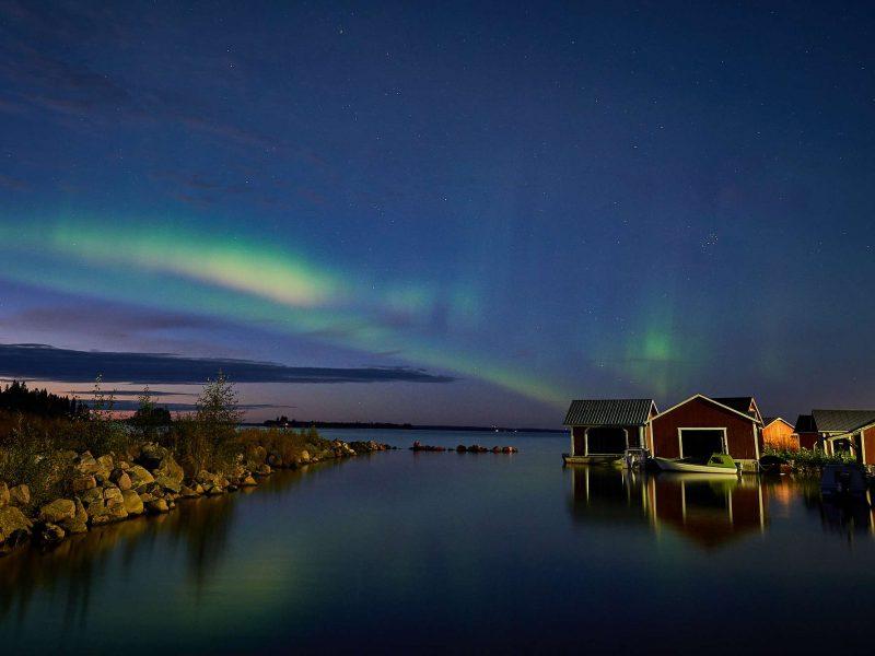swedish lapland northern lights over water brandon lodge gr