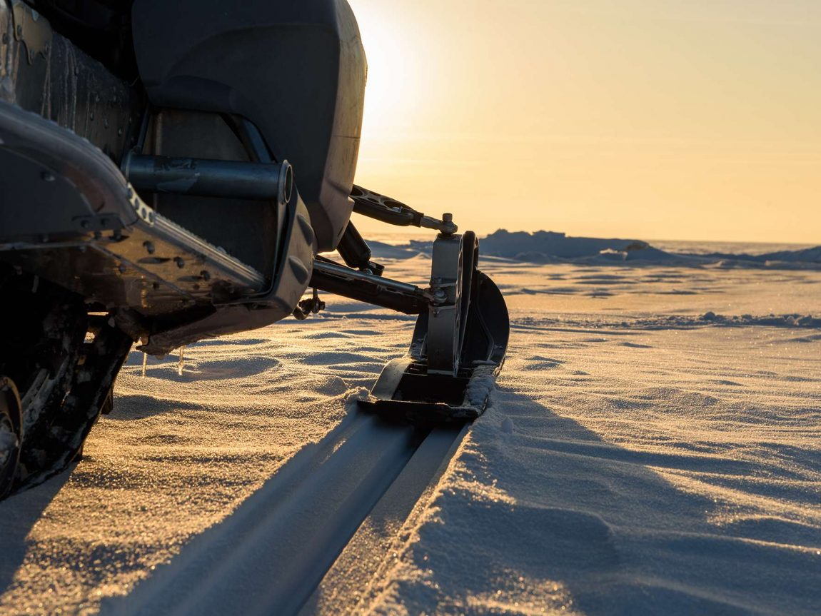 snowmobile at sunset istk