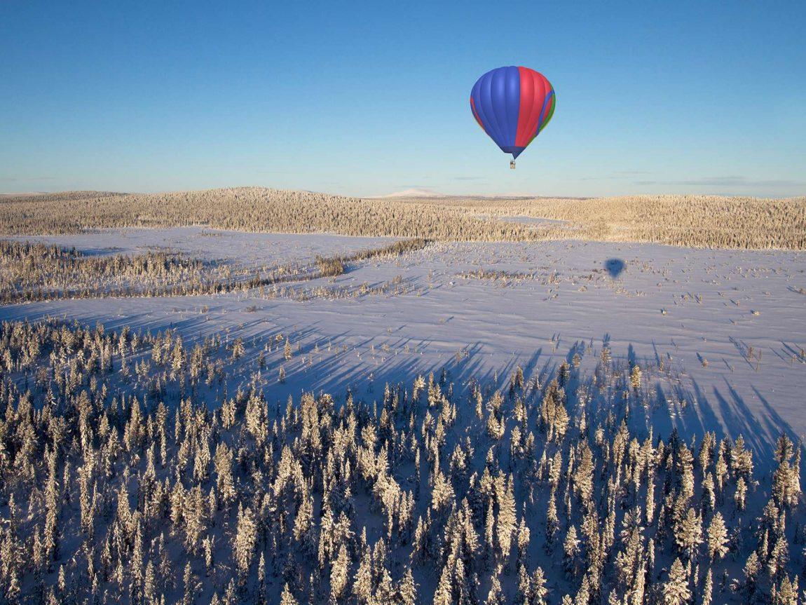 sweden hot air ballooning over lapland winter asc